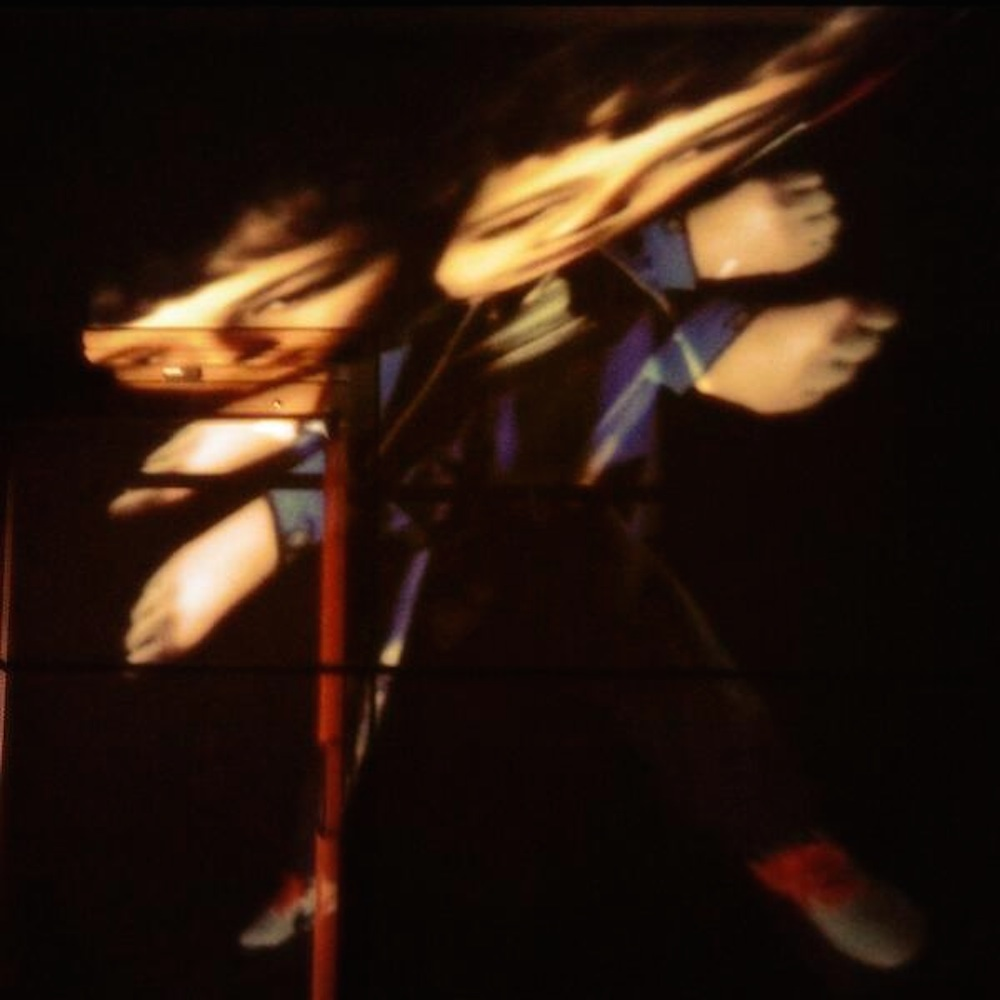 photo of a young person being projected and distorted on to some boxes