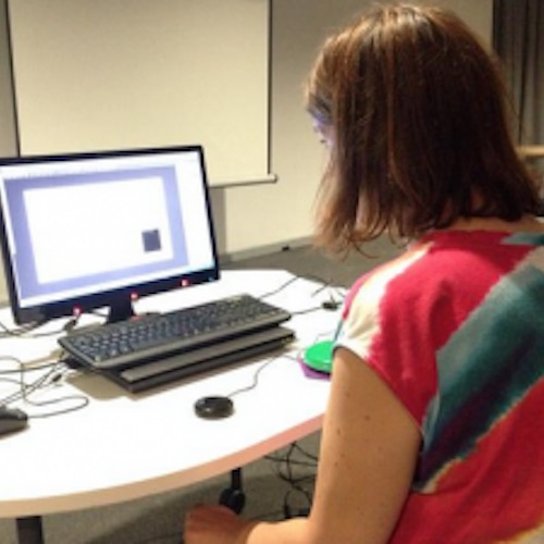 image of gemma nash looking a a computer