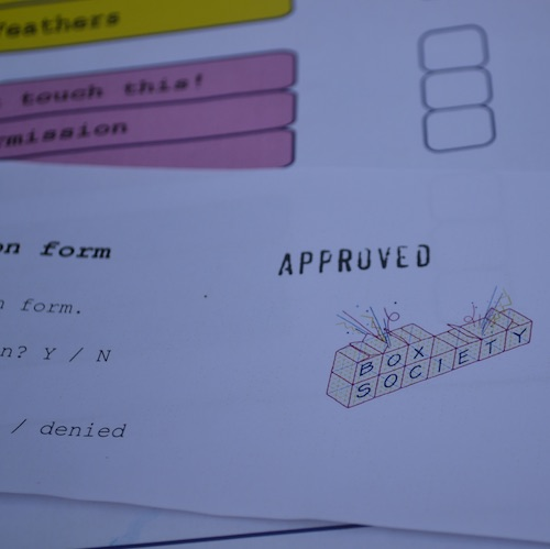 image of forms with 'approved' stamped on one and the 'box society' logo